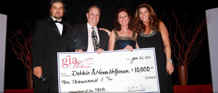 Debbie & Norm Hoffman receiving the Consultant of the Year Award in 2011